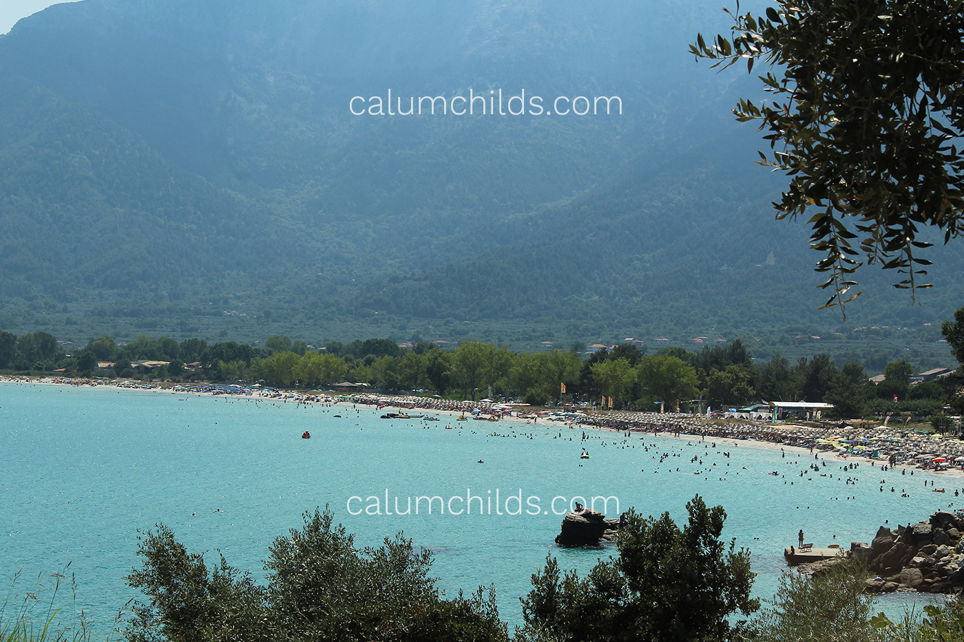 Turquoise waters engulf a beautiful beach.